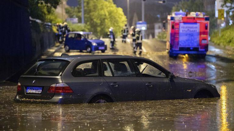 A car stands in a flooded car underpass in Stuttgart. PIc: Marijan Murat/dpa/ AP