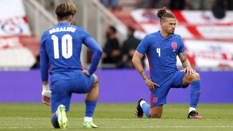 England's Jack Grealish and Kalvin Phillips take a knee before the international friendly match at Riverside Stadium, Middlesbrough on Sunday June 6, 2021