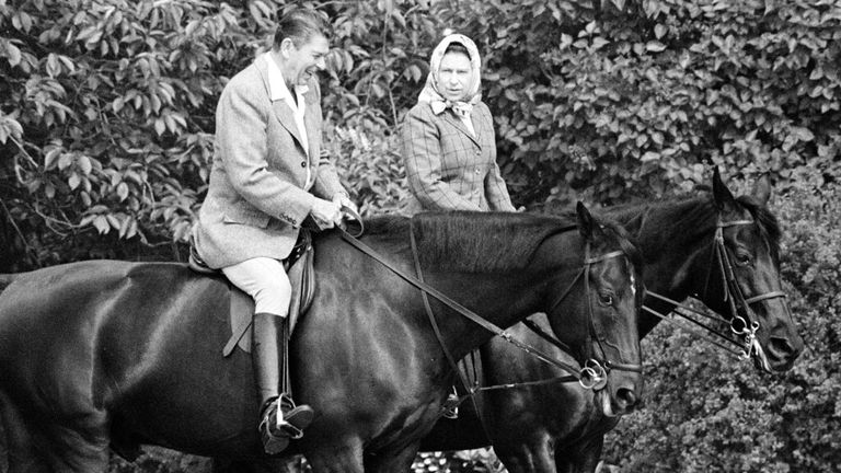 The Queen and Ronald Reagan on horseback in the grounds at Windsor in June 1982. Pic: AP