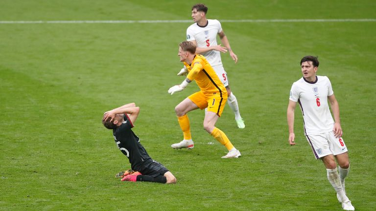 Thomas Mueller holds his head in his hands after missing a golden chance to equalise