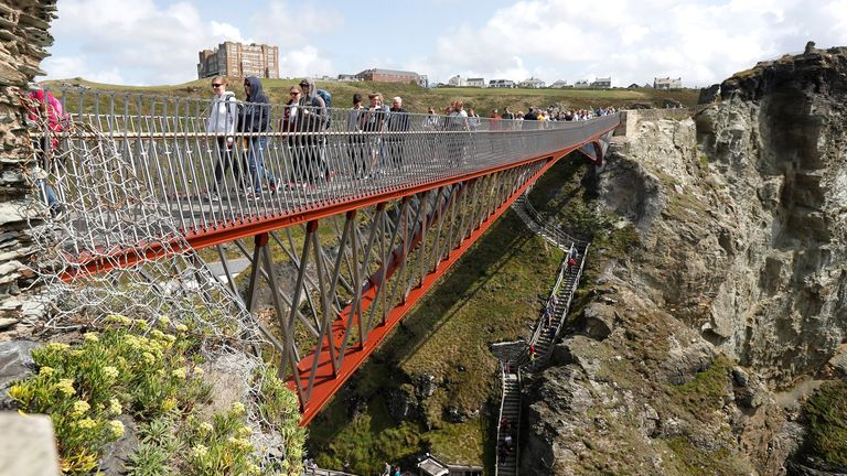 A new and recently opened footbridge is used by tourists to access Tintagel Castle in Tintagel, Britain, August 19, 2019. REUTERS/Peter Nicholls