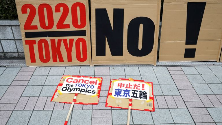 Banners and placards during a rally calling for the cancellation of the Games