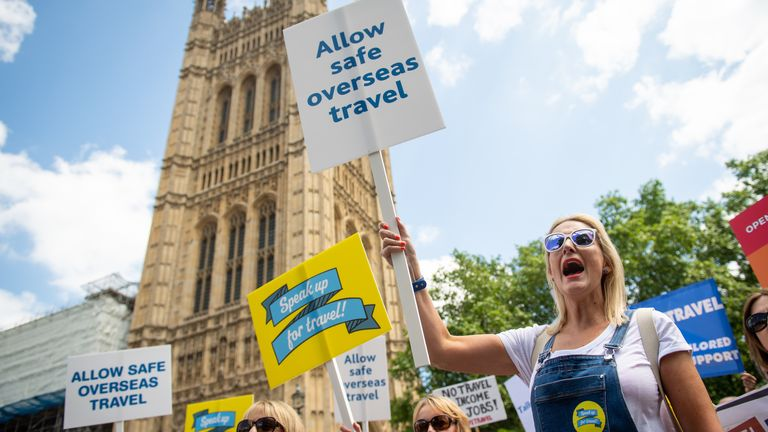 Protestors attend a demonstration by members of the travel industry on College Green, Westminster, central London, during a Travel Day of Action calling on the UK Government to support a safe return to international travel in time for the peak summer period. Picture date: Wednesday June 23, 2021.