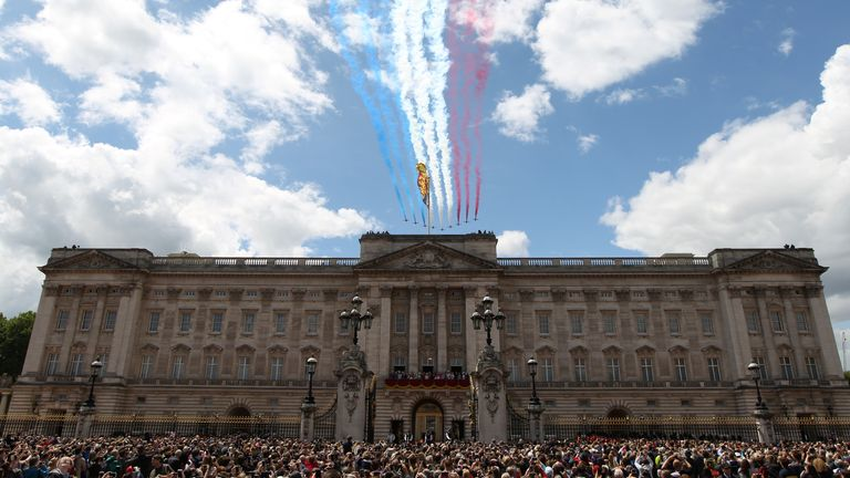 The Royal Air Force Aerobatic Team Red Arrows performs a flypast in 2019