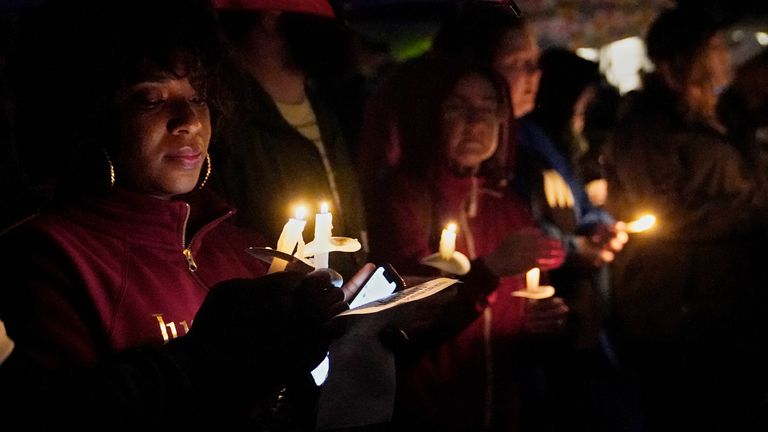 People hold candles at a candlelight vigil in honour of the victims of the Tulsa race massacre. Pic AP