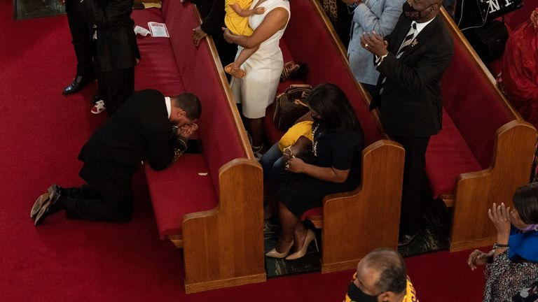 Reverend John Faison Senior kneels in prayer after preaching at a joint service for the centennial of the Tulsa Race Massacre at First Baptist Church of North Tulsa on Sunday. Pic AP
