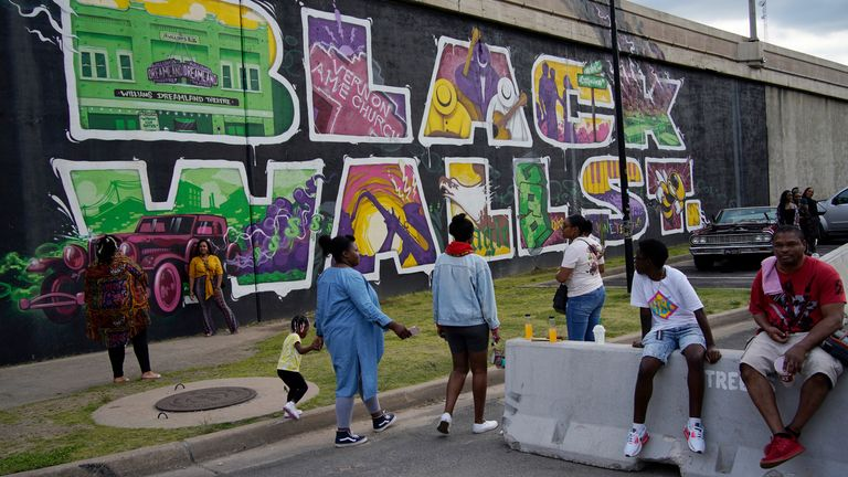 A memorial wall for Black Wall Street in the Greenwood district, where the 1921 massacre took place. Pic AP
