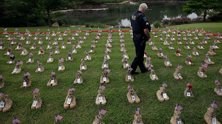 Police Sargeant Joel Ward views the Field of Heroes at Centennial Park. The field contains empty boots to give a visual representation of Oklahoma's fallen service members. Pic AP