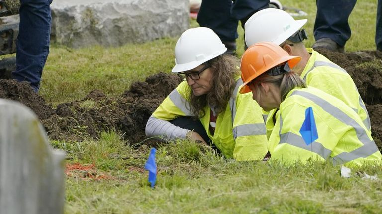 State archaeologist Kary Stackelbeck (left) has estimated that at least 30 bodies could be at the site. Pic AP