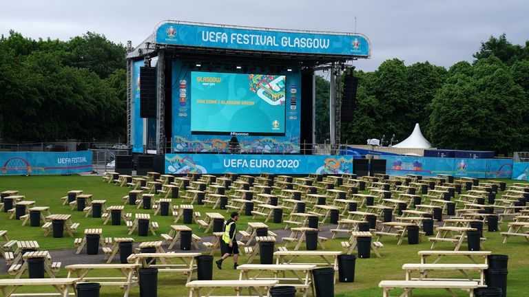 UEFA EURO 2020 Fan Zone at Glasgow Green Aimee Harper (left) and Justine Ralston clean tables as finishing preparations are made to the UEFA EURO 2020 Fan Zone at Glasgow Green. Picture date: Thursday June 10, 2021.