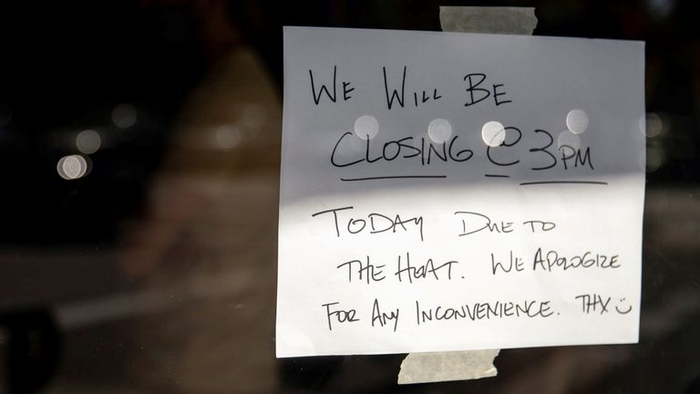 A notice is seen as a business chose to close early due to an unprecedented heat wave in Portland, Oregon, U.S. June 27, 2021. REUTERS/Maranie Staab
