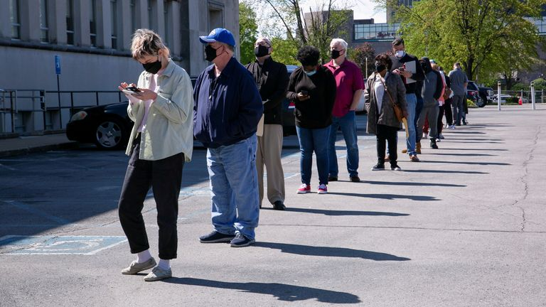 People line up outside a newly reopened career center for in-person appointments in Louisville, U.S., April 15, 2021.