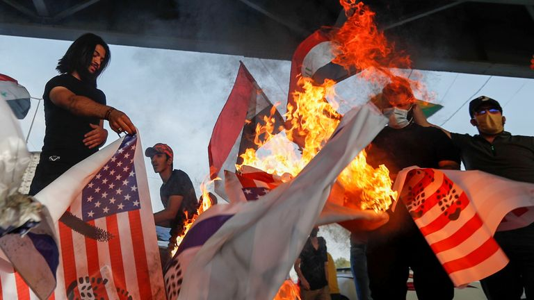 Members of the Kataib Hezbollah militia group, whose facilities were targeted in the strikes, burn US flags in May