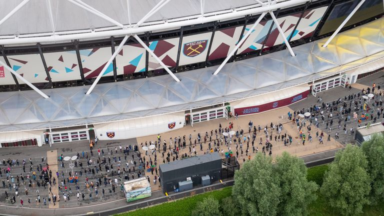 People lined up for jabs at the former Olympic stadium - now used by West Ham - on Saturday