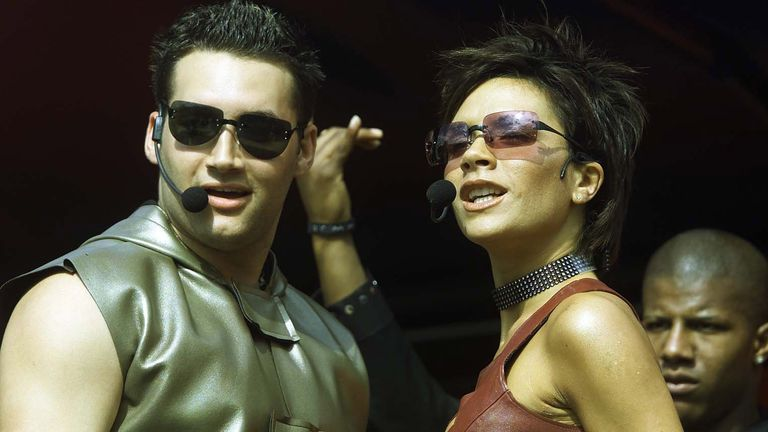 Victoria Beckham, the Spice Girls' Posh Spice, with Another Level's Dane Bowers, performing their song Out Of Your Mind on stage at the Radio 1 Road Show 'Big Sunday' outdoor music event in Middlesbrough in August 2000