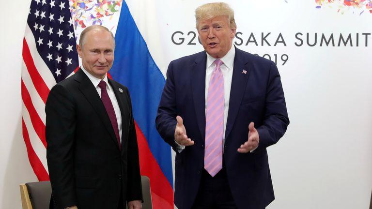 Vladimir Putin and Donald Trump at the G20 in 2019