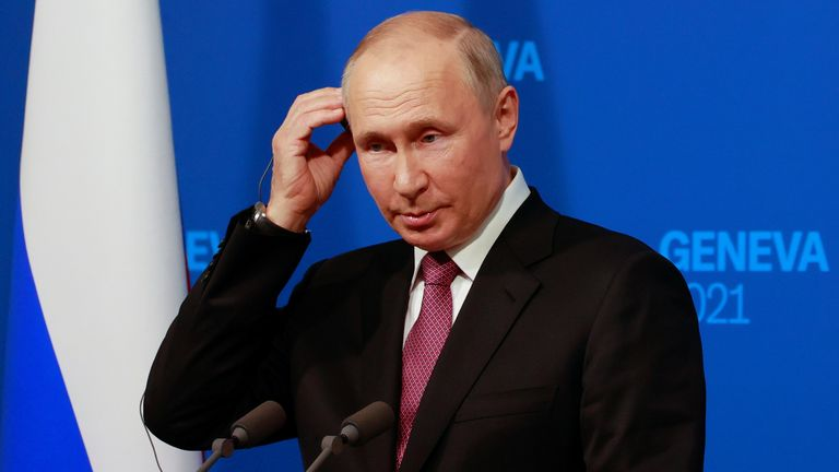 Vladimir Putin holds a news conference after the US-Russia summit