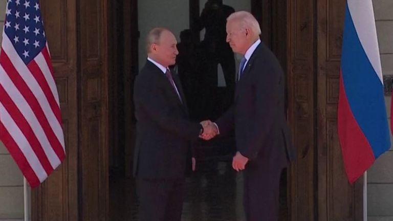 Vladimir Putin and Joe Biden shake hands in Geneva