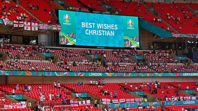 There were cheers as the announcer wished Christian Eriksen well. Pic: AP