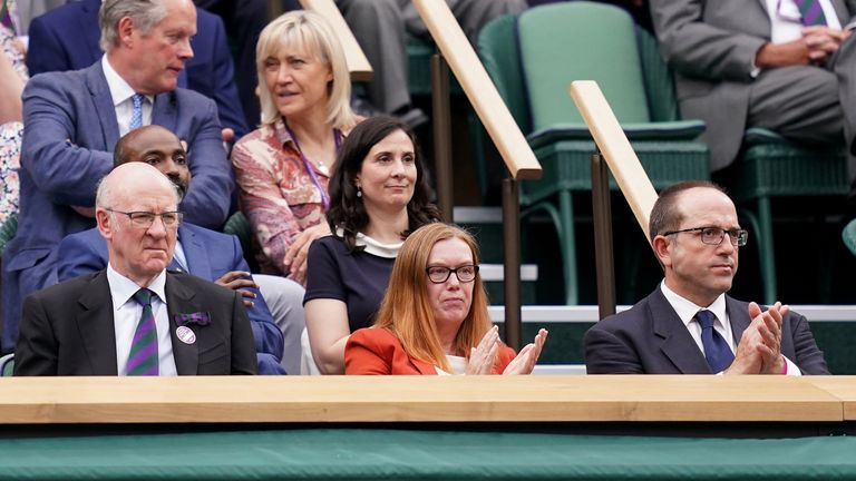Dame Sarah Catherine Gilbert (centre) was given a warm reception when she took her seat at Centre Court