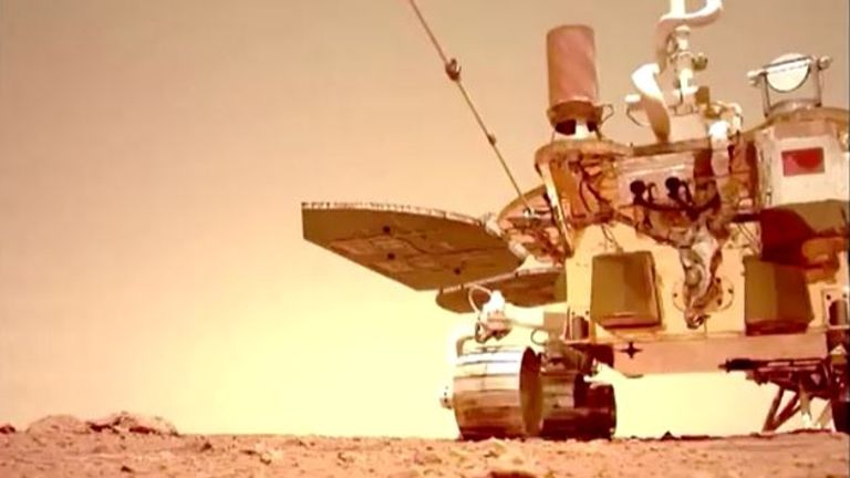A still taken from video footage of the Zhurong rover moving along the Martian surface