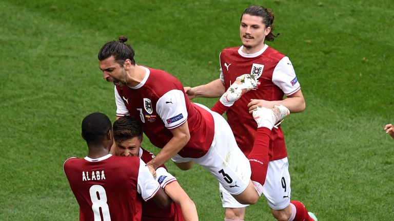 Austria's Christoph Baumgartner celebrates with teammates after scoring his sides first goal during the Euro 2020 soccer championship group C match between Ukraine and Austria