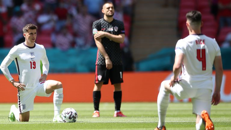 England's Mason Mount and Declan Rice take the knee before the Euro 2020 Group D match against Croatia
