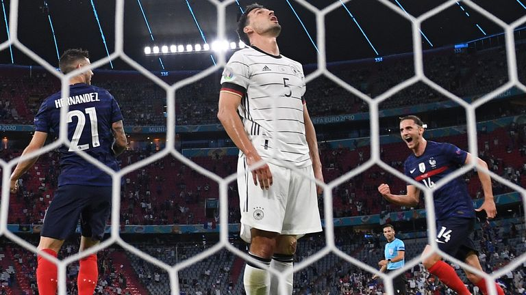Germany's Mats Hummels looks dejected after scoring an own goal for France's first goal as Lucas Hernandez and Adrien Rabiot celebrate