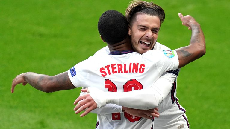 Raheem Sterling celebrates with Jack Grealish after opening the scoring against Czech Republic