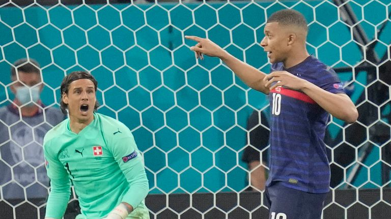 Kylian Mbappe has his decisive penalty kick saved by Switzerland's Yan Sommer