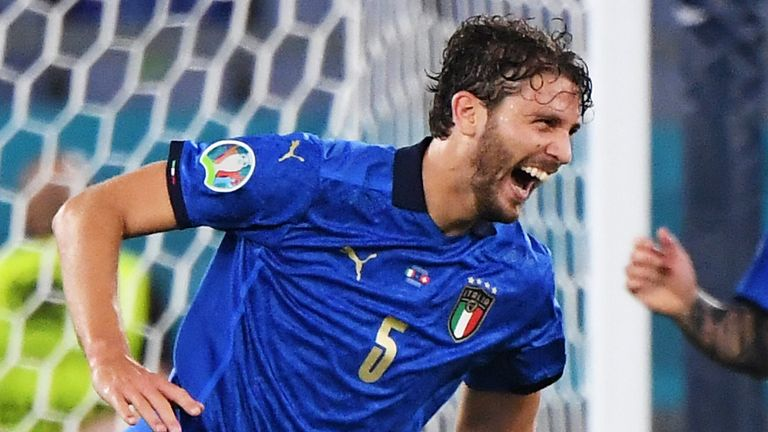 Manuel Locatelli wheels away in celebration after scoring his second goal against Switzerland