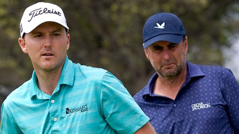 Russell Henley, left, watches his putt on the fifth green as Richard Bland, of England, looks on during the third round of the U.S. Open Golf Championship, Saturday, June 19, 2021, at Torrey Pines Golf Course in San Diego. (AP Photo/Marcio Jose Sanchez)