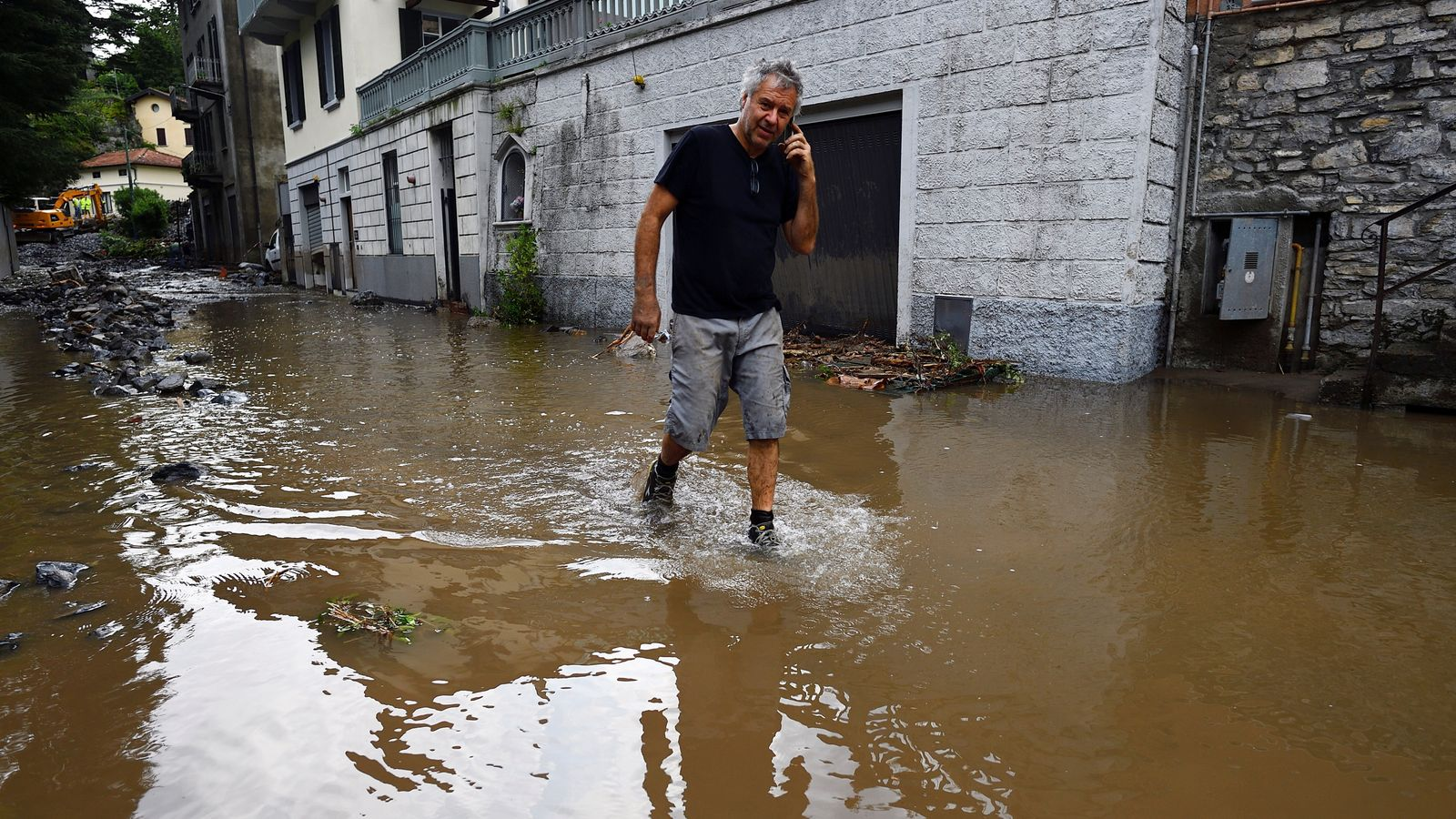Italy flooding: Dozens rescued after towns around popular tourist spot Lake Como hit by landslides and heavy rain