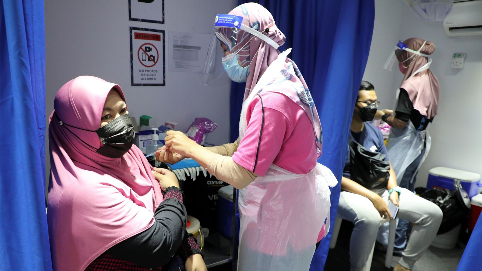 COVID-19: Woman given 'empty vaccination' by exhausted nurse in Malaysia