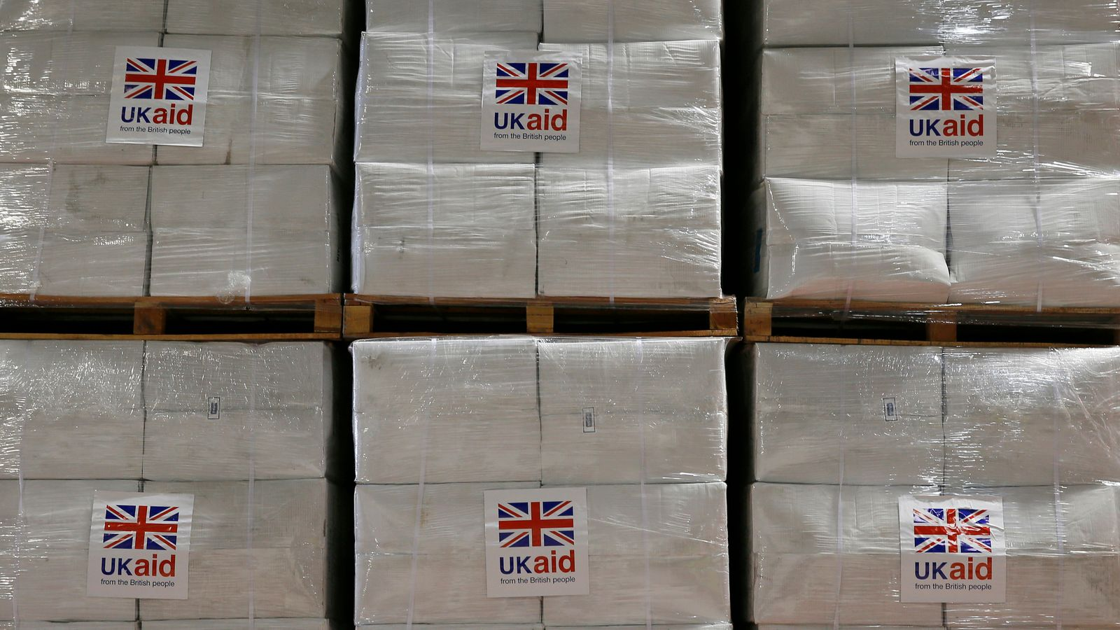 MPs to vote on foreign aid budget cuts, but tax rises are threatened if government loses