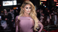 Katie Price poses for photographers upon arrival at the premiere of the film 'Fifty Shades Darker', in London, Thursday, Feb. 9, 2017. (Photo by Vianney Le Caer/Invision/AP)