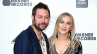 Tom Meighan and guest attending the As It Was Premiere at Alexandra Palace Theatre, London.