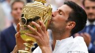 Serbia's Novak Djokovic kisses his winner's trophy and celebrates his victory over Italy's Matteo Berrettini during the men's singles final match on day thirteen of the Wimbledon Tennis Championships in London, Sunday, July 11, 2021. (AP Photo/Alberto Pezzali)