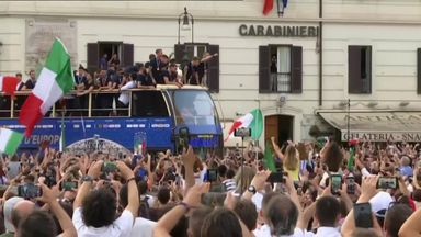 Italy show off trophy on bus parade!