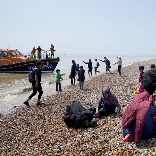 Exhaustion for migrants as they complete final part of their perilous journey