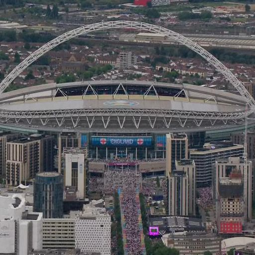 Fans break through security barriers and run into Wembley