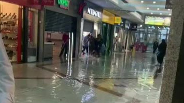Flood water cascades through London shopping centre