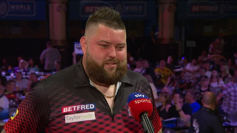 Michael Smith advanced into the last 16 of the World Matchplay with a 10-7 success against Ryan Searle