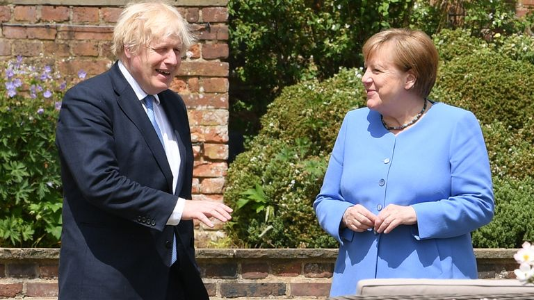Prime Minister Boris Johnson and the Chancellor of Germany, Angela Merkel, walk through the garden at Chequers, the country house of the Prime Minister of the United Kingdom, in Buckinghamshire. Picture date: Friday July 2, 2021.