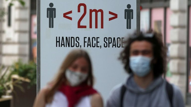 Two people wearing masks in front of a social distancing sign in Regent Street, London, following the easing of lockdown restrictions in England. Covid-19 case rates are rising in more local areas of the UK than at any point since early January. Picture date: Monday June 7, 2021.