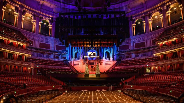 EDITORIAL USE ONLY Staff install and switch on a new sign at the Royal Albert Hall in London, as it prepares to celebrate its 150th anniversary.