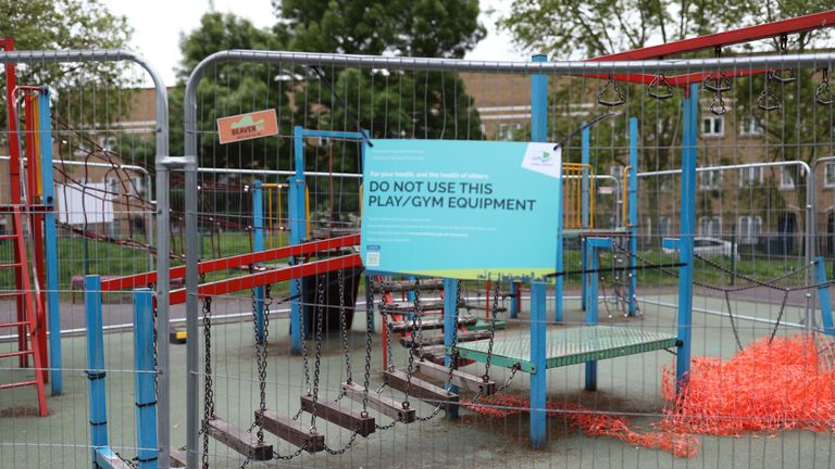 Activity equipment in the children's playground area of a park in London is closed off, as the UK continues in lockdown to help curb the spread of the coronavirus.