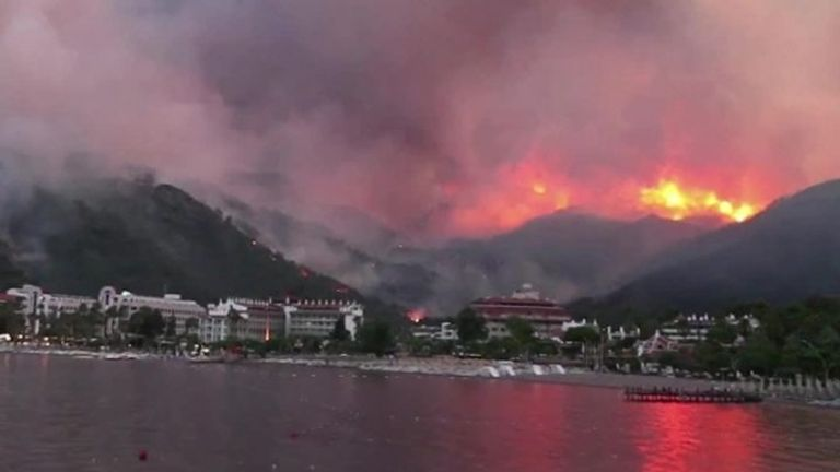 Wildfires blaze along Turkey's southern coast for a third day after the death toll rises to four.