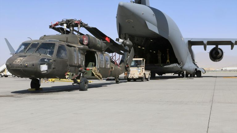 A Blackhawk helicopter is loaded on to a plane during preparation for withdrawal last month