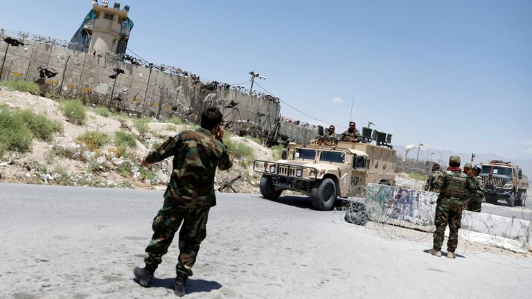 Afghan soldiers stand guard at a checkpoint outside the U.S Bagram air base, on the day the last of American troops vacated it, Parwan province, Afghanistan July 2, 2021.REUTERS/Mohammad Ismail